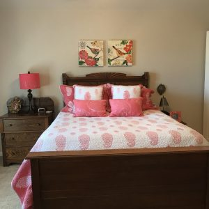 photo of bed and bedside table
