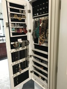 Jewelry stored in mirror armoire