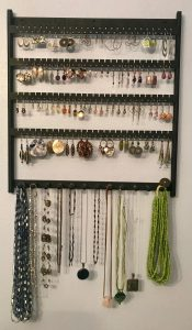 Wall mount jewelry holder with earrings and necklaces